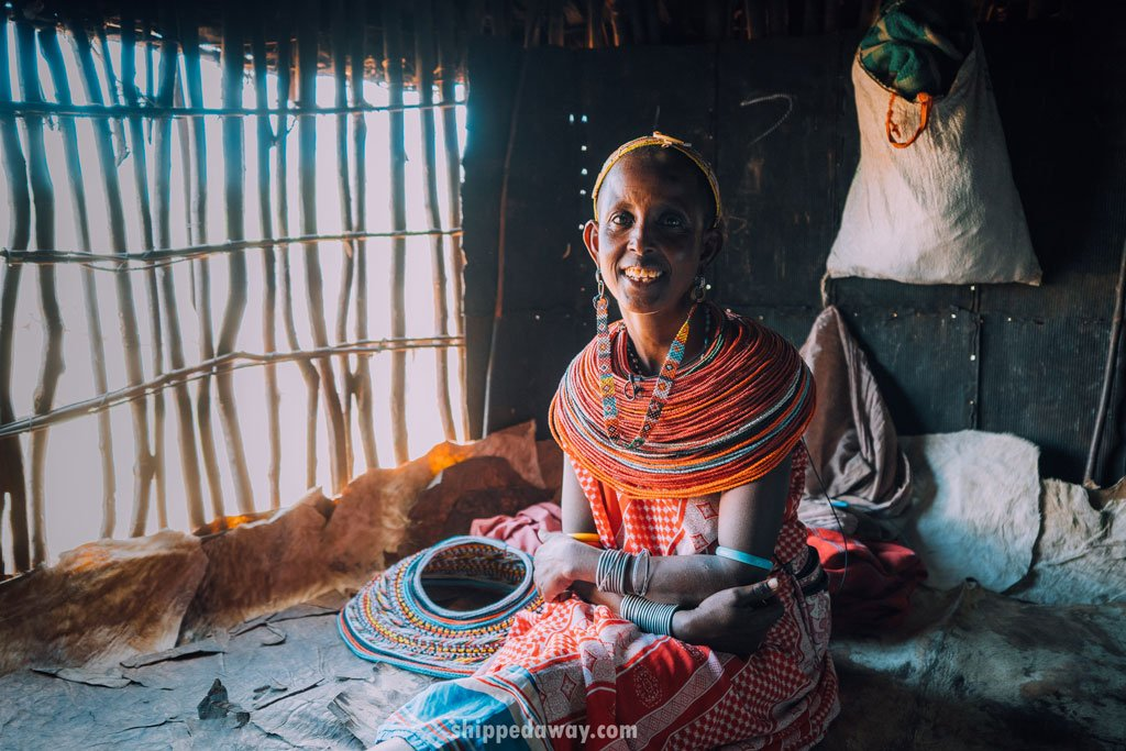 Woman inside a hut of the Maasai Samburu tribe in Kenya