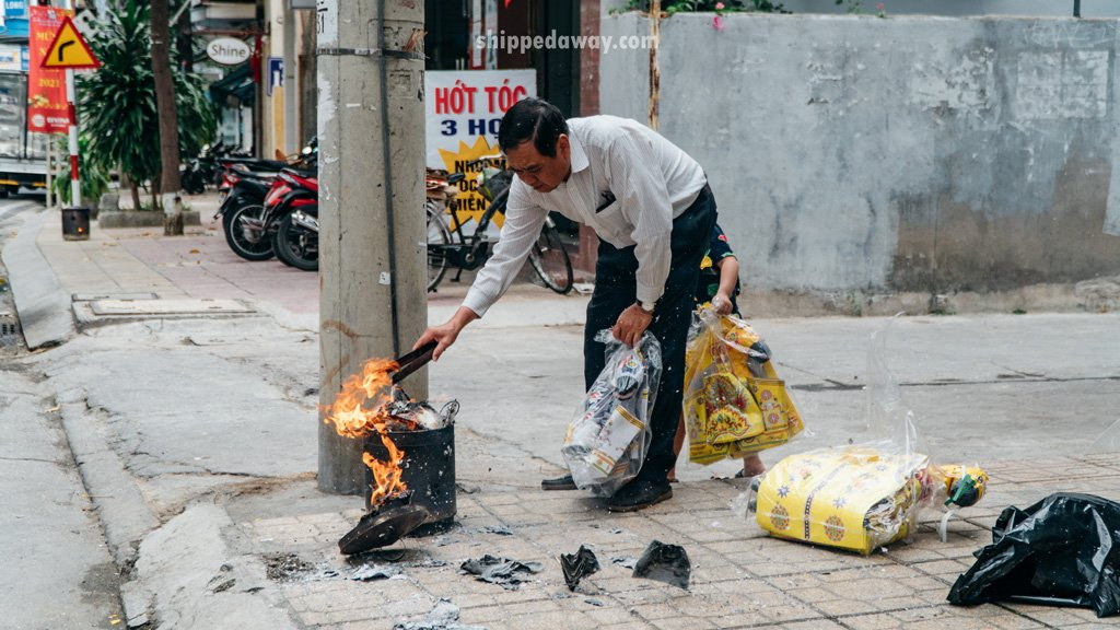 Burning ritual during offerings before Tet, Vietnamese New Year