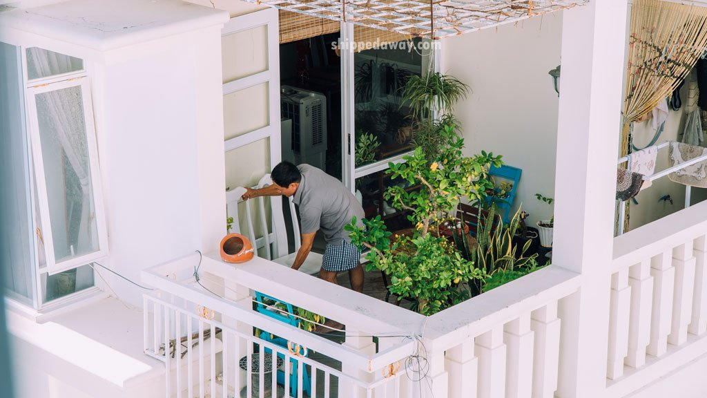 Man cleaning house before Tet, Vietnamese New Year
