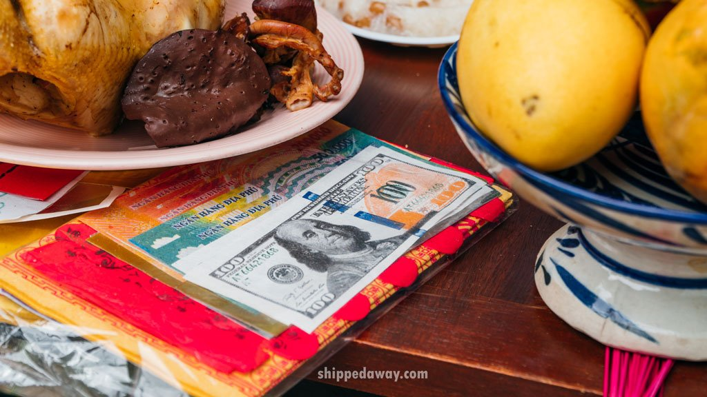 Fake money placed on the family altar during the offering ritual before Tet, Vietnamese New Year