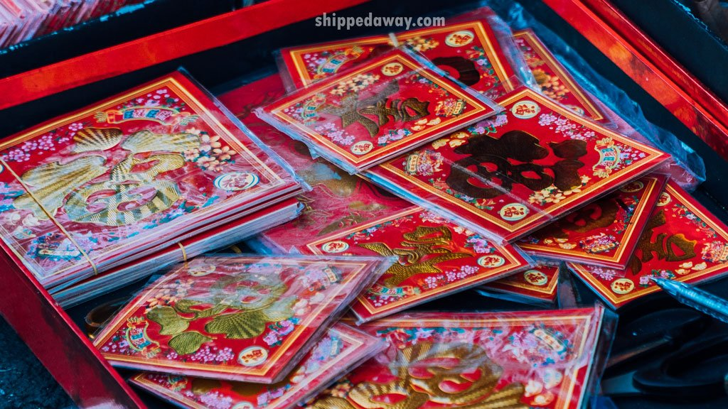Red envelopes used for gifting children money, found on a market before Tet, Vietnamese New Year